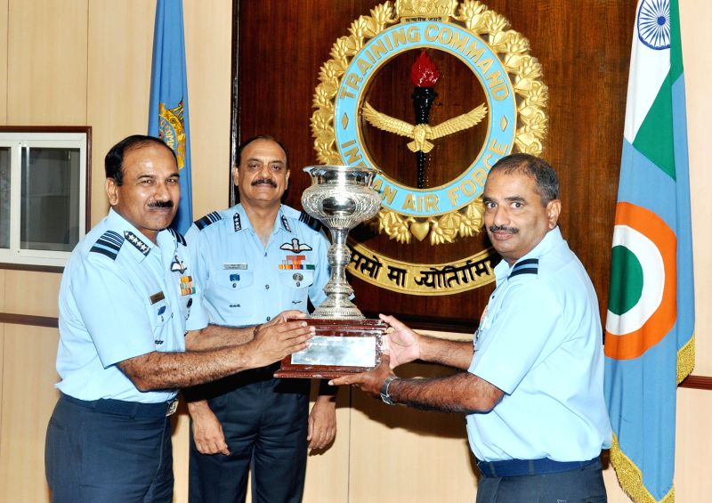 The Chief of the Air Staff, Air Chief Marshal Arup Raha presents the best in administration trophy to Air Commodore K.L. Yadav, AOC Jalahalli, in Bengaluru on April 9, 2015. Also seen Air ... - Marshal Ramesh Rai