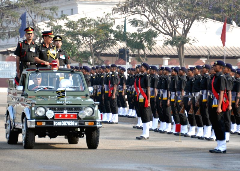 The Commandant of ASC Centre and College and Colonel Commandant of ASC, Lieutenant General S P S Katewa reviews the passing out parade, in Bengaluru on March 25, 2015.