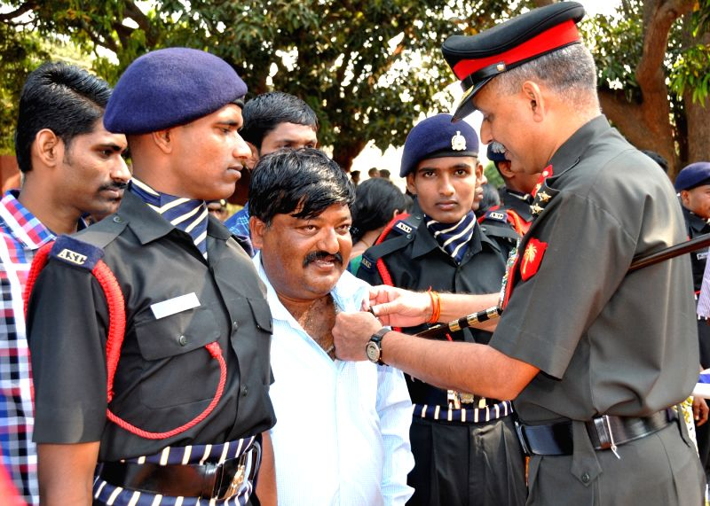 The Commandant of ASC Centre (North) Brigadier Alok Tripathi presents `Gaurav Padak` to the parents of the new recruits during the passing out parade ceremony, in Bengaluru on March 25, ... - Alok Tripathi
