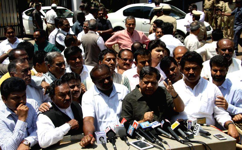 The leader of opposition in Karnataka Assembly Jagadish Shettar, JDS leader H. D. Kumaraswamy and others address press after submitting a memorandum demanding CBI probe in the mysterious ...