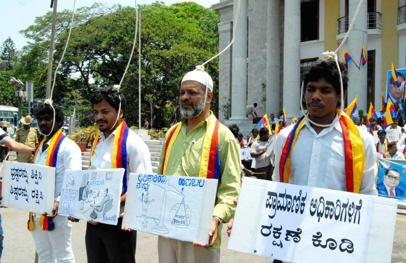 The members Karnataka Dalit Minorities Sene stage a demonstration to demand punishment for the alleged culprits in the mysterious death of Karnataka IAS DK Ravi, in Bengaluru on March 30, ...