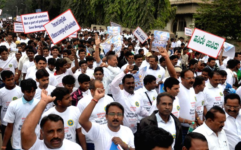 The members of Akhila Bharatiya Ekta Manch participate in `Walk for Bengaluru`  in Bengaluru, on Dec 28, 2014.