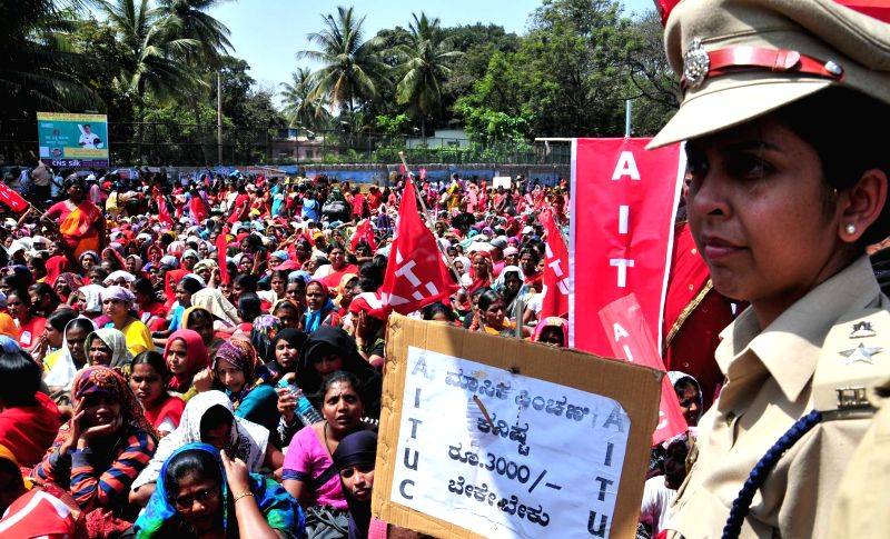 The members of Karnataka State Anganwadi Workers Association stage a demonstration to press for a hike in their salary at Freedom Park in Bengaluru, on Feb 12, 2015.