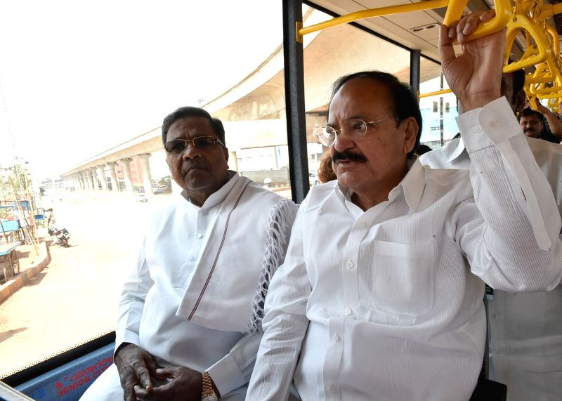 The Union Minister for Urban Development, Housing and Urban Poverty Alleviation and Parliamentary Affairs, M. Venkaiah Naidu and Karnataka Chief Minister Siddaramaiah travel in a metro ... - Siddaramaiah and M. Venkaiah Naidu