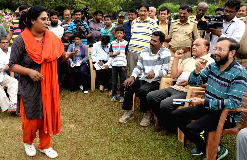 The Union Minister of State for Environment, Forest and Climate Change (Independent Charge) and BJP leader Prakash Javadekar interacts with people at the Cubbon Park in Bengaluru, on April ...