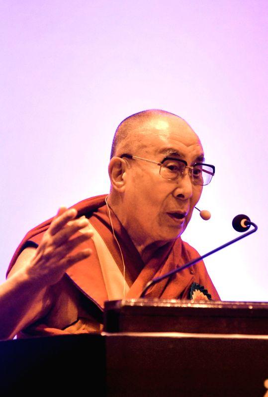 ":Bengaluru: Tibetan spiritual leader the Dalai Lama addresses during ""Thank You Karnataka"" an event to mark 60th year of Tibetan arrival to India, in Bengaluru on Aug 10, 2018. (Photo: IANS)."