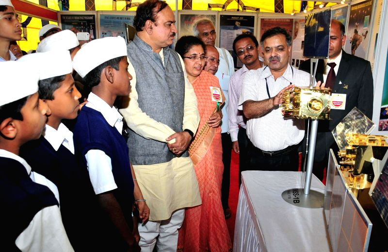 Union Chemicals and Fertilizers Minister Ananth Kumar looks at models on display during Adamya Chetana Utsav at National College Grounds in Bengaluru, on Jan 1, 2015.