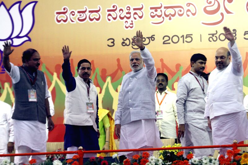 Union Chemicals and Fertilizers Minister Ananth Kumar, Karnataka BJP chief Prahalad Joshi, Prime Minister Narendra Modi and BJP chief Amit Shah during a public meeting in Bengaluru, on ... - Ananth Kumar, Narendra Modi, Prahalad Joshi and Amit Shah