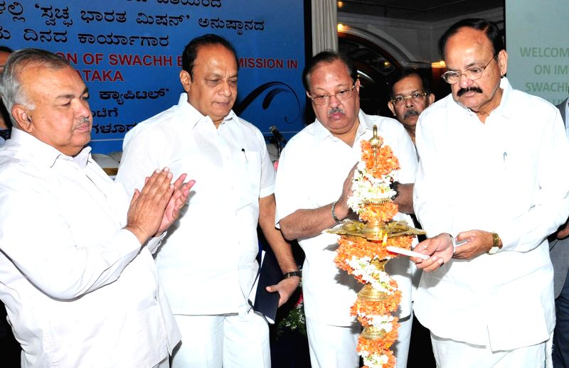 Union Minister for Urban Development, Housing and Urban Poverty Alleviation and Parliamentary Affairs M Venkaiah Naidu, Karnataka Transport Minister Ramalinga Reddy and Karnataka Municipal ... - Ramalinga Reddy