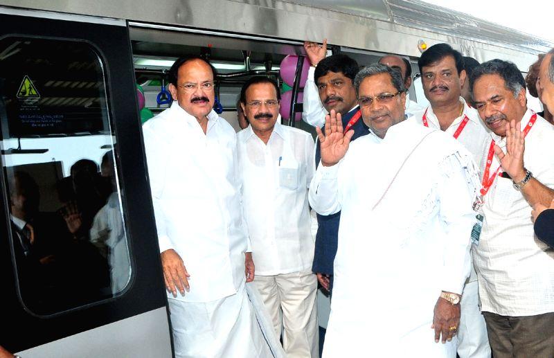 Union Ministers M. Venkaiah Naidu, D. V. Sadananda Gowda, Karnataka Chief Minister Siddaramaiah and others  at the inaugural function of the Namma Metro Line of Reach -3B, at Peenya ... - Karnataka Chief Minister Siddaramaiah, M. Venkaiah Naidu and D. V. Sadananda Gowda