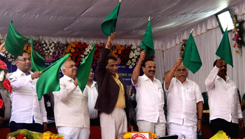 Bengaluru : Union Railways Minister Suresh Prabhu with DV Sadananda Gowda, Union Law Minister and others flagging off new trains at Bangalore City Railway Station, in Bengaluru on Jan. 29, 2015.