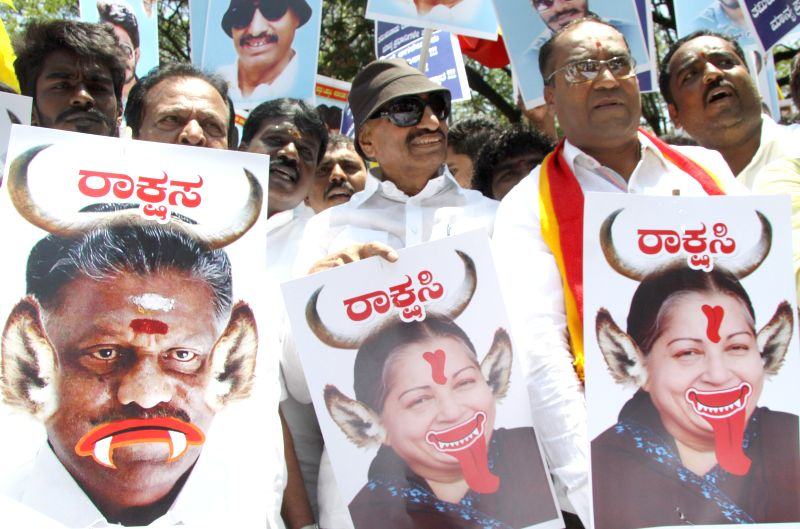 Various Kannada organisations protest against Tamil Nadu Chief Minister O Panneerselvam and AIADMK supremo J Jayalalithaa over Tamil Nadu`s objection to the proposed Mekedatu dam project ...