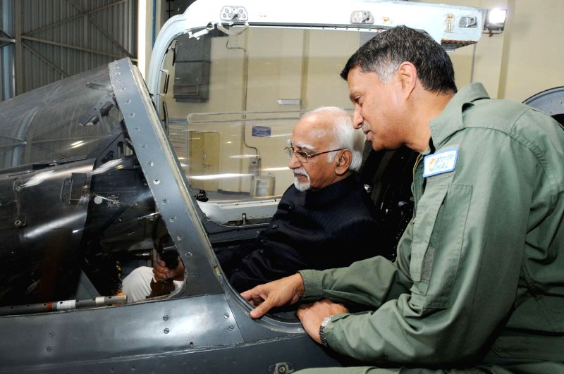 Vice-President Mohammad Hamid Ansari visits the hangar of Hindustan Aeronautics Limited in Bengaluru on Jan 7, 2015.