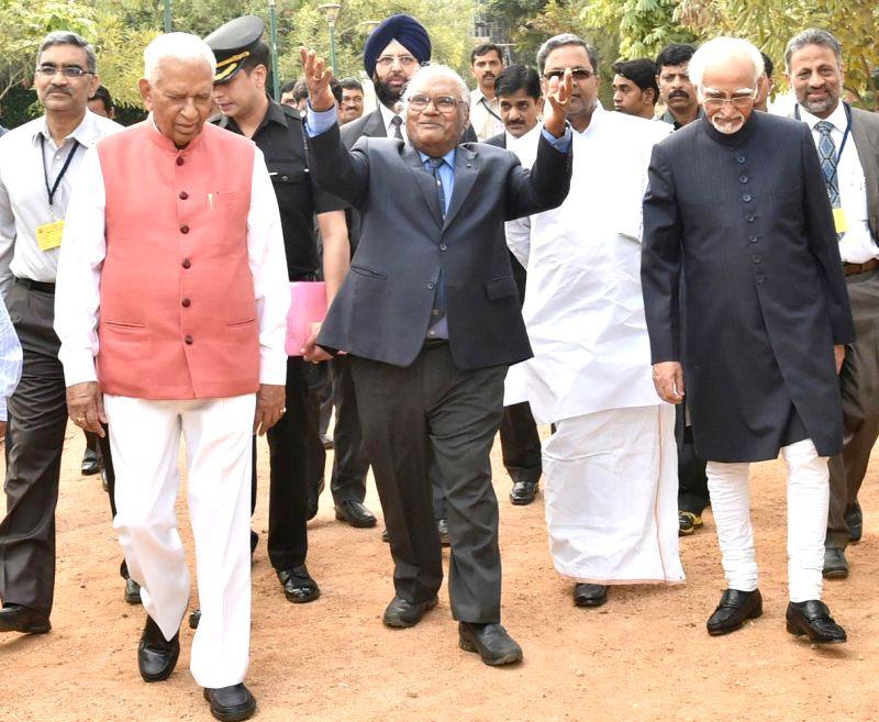 Vice President Mohd. Hamid Ansari, Karnataka Chief Minister Siddaramaiah, Karnataka Governor Vajubhai Rudabhai Vala and eminent scientist CNR Rao during the Silver ... - Siddaramaiah