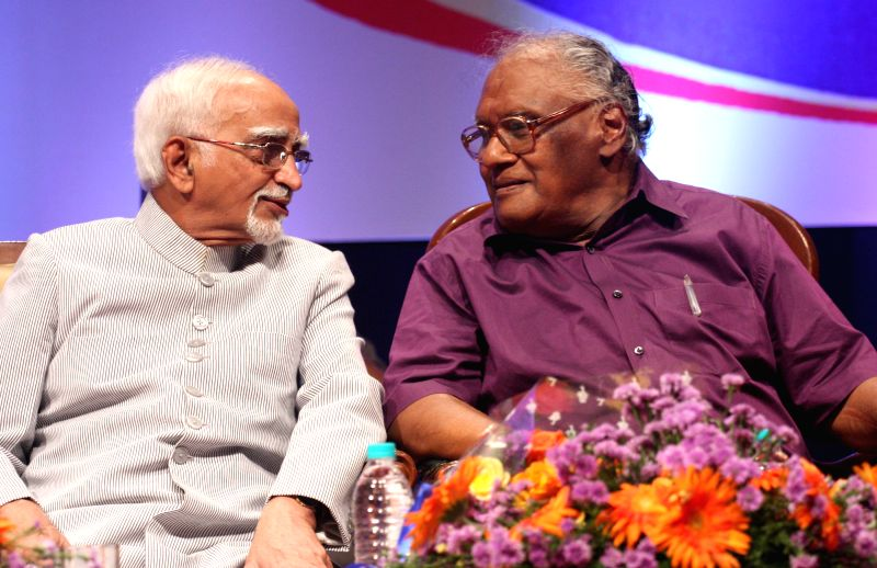 Vice President Mohd. Hamid Ansari interacts with eminent scientist CNR Rao at the inauguration of the 15th All India People`s Science Congress to 2015 on the theme `science for social ...