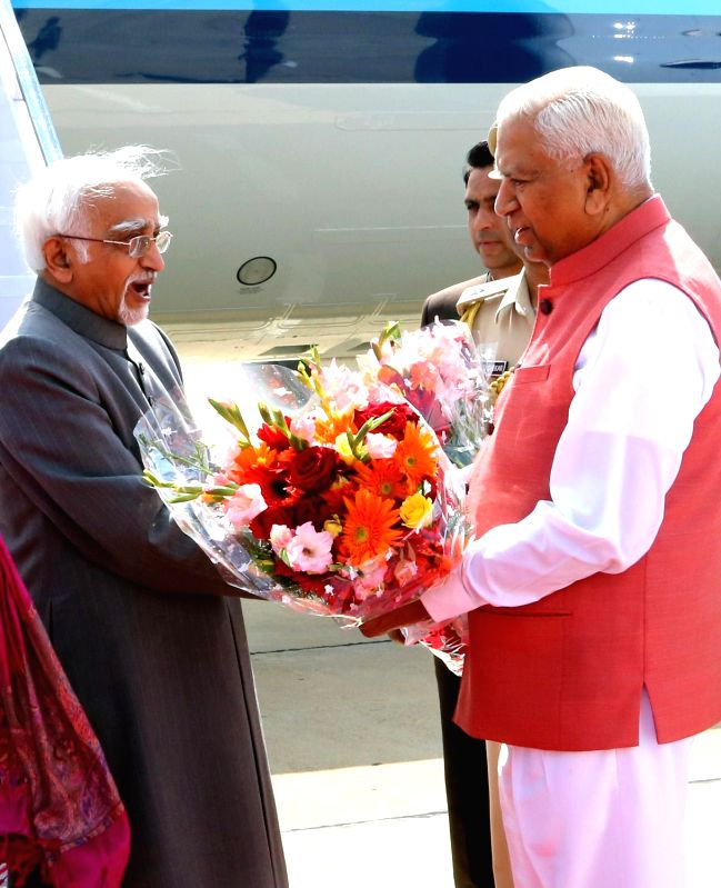 Vice President Mohd. Hamid Ansari being received by the Governor of Karnataka Vajubhai Rudabhai Vala on his arrival at the HAL airport Bengaluru on Jan. 5, 2015.