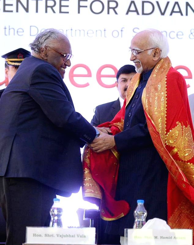 Vice President Mohd. Hamid Ansari being felicitated by eminent scientist CNR Rao during the Silver Jubilee celebrations of Jawaharlal Nehru Centre for Advance Scientific ...