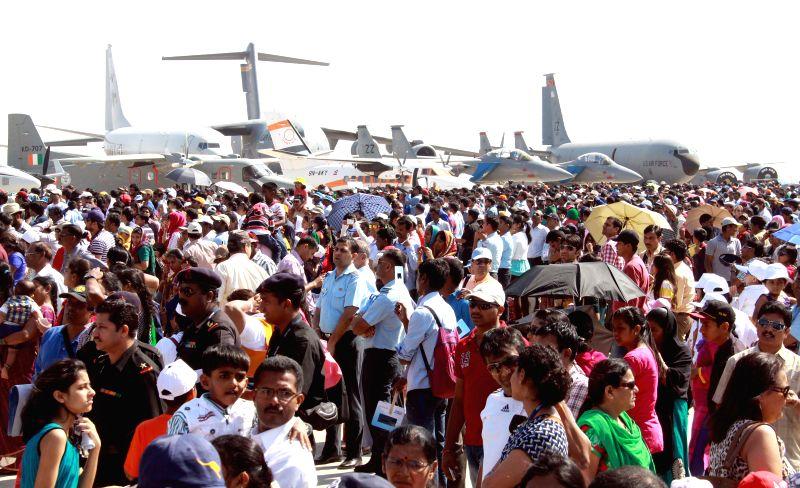 Visitors at the Aero India-2015 Air Show, at Yelahanka Air-force Station, in Bengaluru on Feb 21, 2015.