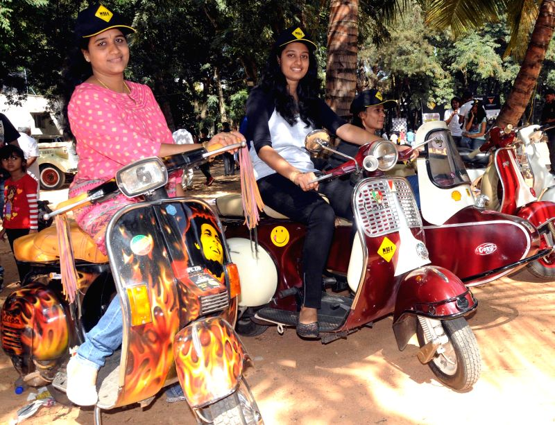 Visitors at the Southern India Vintage Automobile Exhibition organised at Jayamahal Palace Grounds in Bengaluru, on Nov 23, 2014.