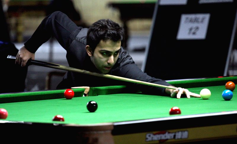 World Billiards Champion Pankaj Advani during a game against Moh Keen Hoo of Malaysia during IBSF World Snooker Championships at Kanteerava Stadium , in Bengaluru on Nov 19, 2014.
