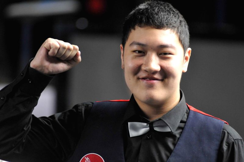 Yan Bingtao (Mens) of China during the prize distribution ceremony of IBSF World Snooker Championships at Kanteerava Stadium, in Bengaluru on Nov. 29, 2014.