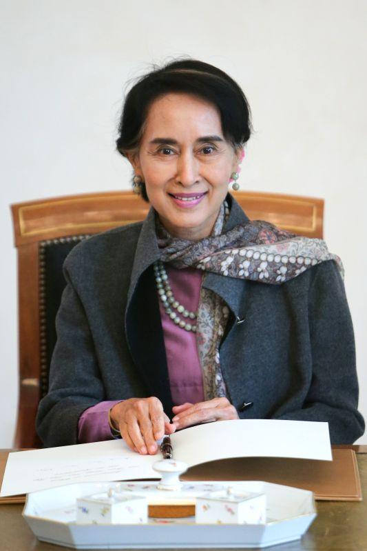Myanmar opposition leader Aung San Suu Kyi smiles after signing on the guestbook at the Presidential Palace in Berlin, Germany, on April 10, 2014. Suu Kyi arrived ..