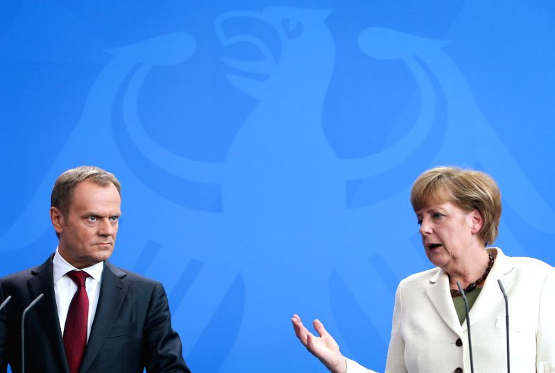 German Chancellor Angela Merkel (R) and visiting Polish Prime Minister Donald Tusk attend a press conference at the Chancellery in Berlin, Germany, on April 25, ... - Donald Tusk