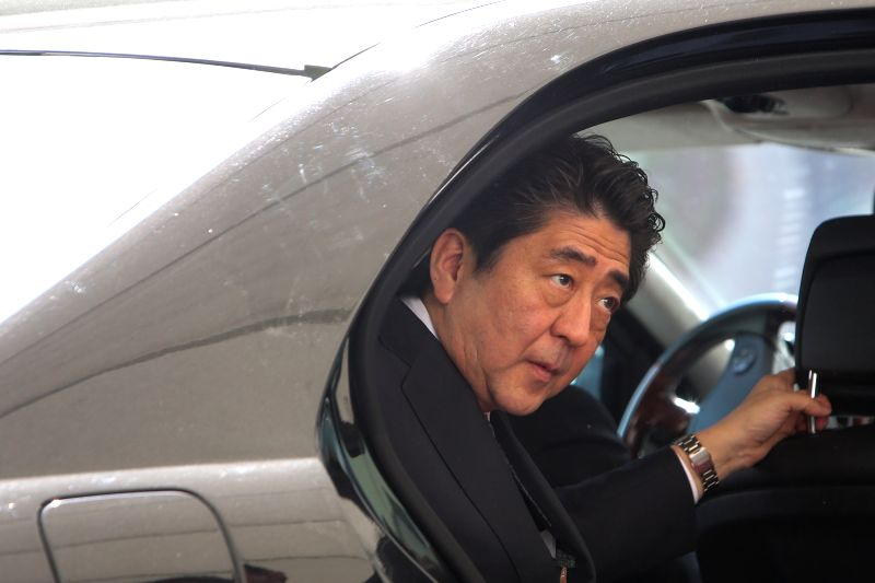 Visiting Japanese Prime Minister Shinzo Abe arrives for the welcoming ceremony held by German Chancellor Angela Merkel (not in the picture) at the Chancellery in ...