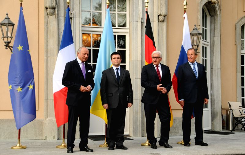 French foreign minister Laurent Fabius, Ukrainian foreign minister Pavlo Klimkin, German foreign minister Frank-Walter Steinmeier and Russian foreign minister Sergey - Laurent Fabius