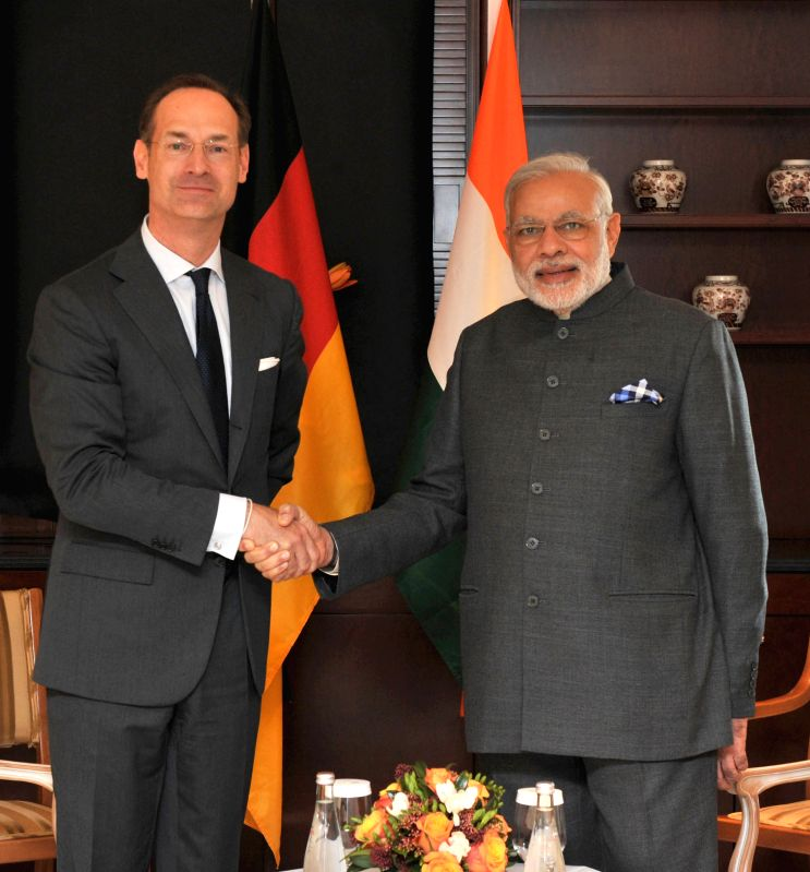 CEO (Des.), Allianz, Oliver Baete meets the Prime Minister Narendra Modi, at Berlin, in Germany on April 14, 2015. - Narendra Modi