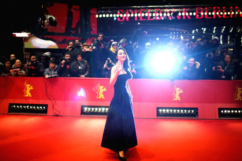 """Zhou Yun poses for photos on the red carpet for the promotion of the movie """"Gone With The Bullets"""" (Yi Bu Zhi Yao) at the 65th Berlinale International Film"""