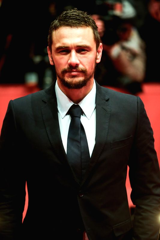 "James Franco poses for photos on the red carpet for the movie ""Queen of the Desert"" at the 65th Berlinale International Film Festival in Berlin, Germany, on"