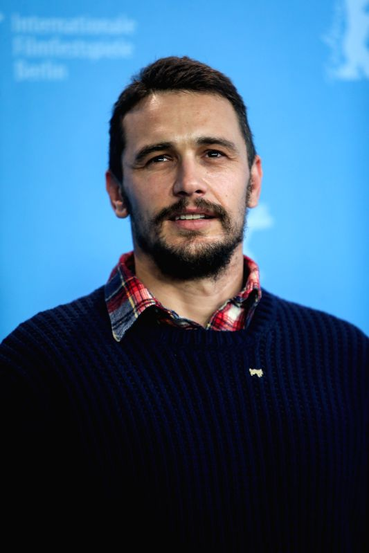 "James Franco poses for photos during a photocall to promote the movie ""Queen of the Desert"" at the 65th Berlinale International Film Festival in Berlin, ..."