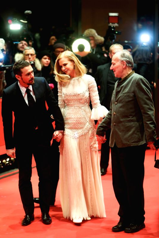 "(Lto R) James Franco, Nicole Kidman and director Werner Herzog pose for photos on the red carpet for the movie ""Queen of the Desert"" at the 65th Berlinale .."