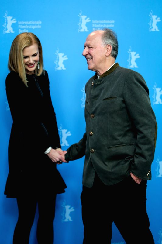 "Nicole Kidman (L) shakes hands with director Werner Herzog during a photocall to promote the movie ""Queen of the Desert"" at the 65th Berlinale International .."