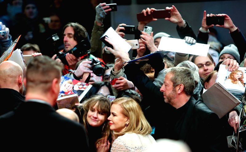 "Nicole Kidman poses for photos with fans on the red carpet for the movie ""Queen of the Desert"" at the 65th Berlinale International Film Festival in Berlin, ."