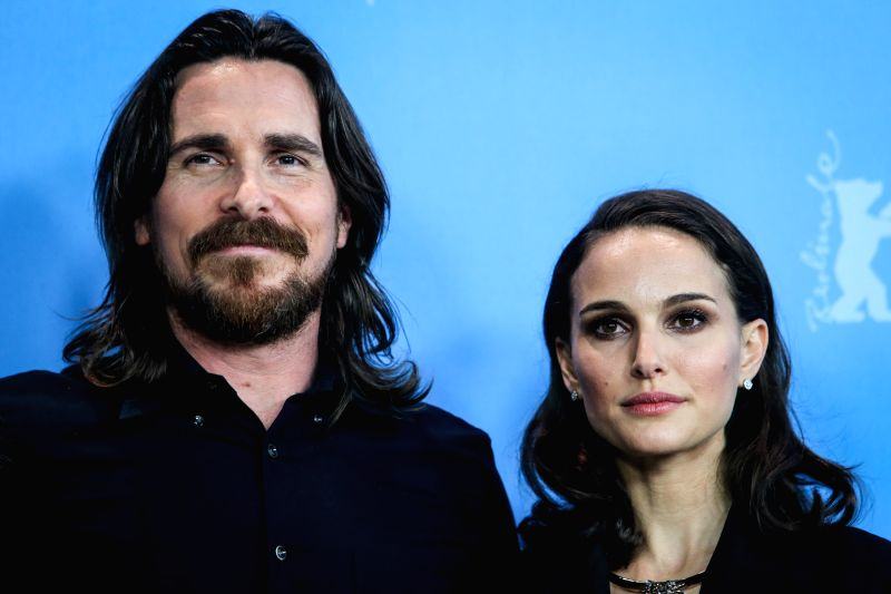 "Christian Bale (L) and Natalie Portman pose for photos for the promotion of the movie ""Knights of Cups"" at the 65th Berlinale International Film Festival in"