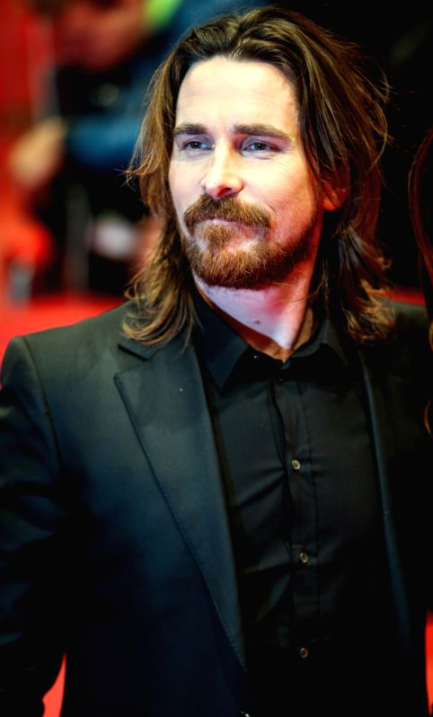 "Christian Bale poses for photos on the red carpet for the promotion of the movie ""Knights of Cups"" at the 65th Berlinale International Film Festival in ...(Image Source: Xinhua)"