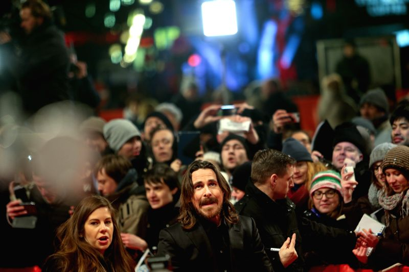 """Christian Bale poses for photos on the red carpet for the promotion of the movie """"Knights of Cups"""" at the 65th Berlinale International Film Festival in ..."""