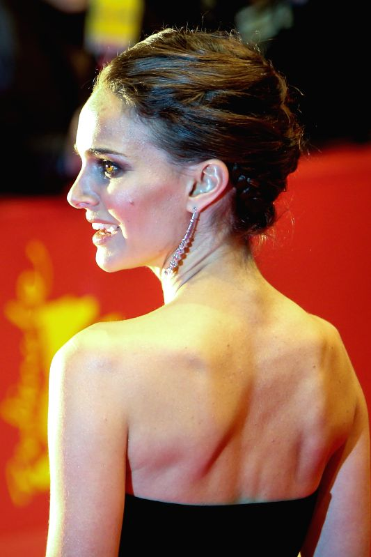 "Natalie Portman poses for photos on the red carpet for the promotion of the movie ""Knights of Cups"" at the 65th Berlinale International Film Festival in ..."