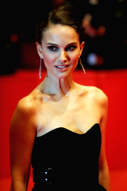 """Natalie Portman poses for photos on the red carpet for the promotion of the movie """"Knights of Cups"""" at the 65th Berlinale International Film Festival in ..."""