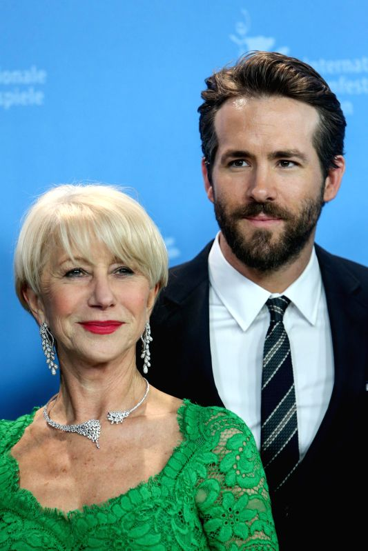 """Helen Mirren (L) and Ryan Reynolds pose for photos during a photocall for the promotion of the movie """"Woman in Gold"""" at the 65th Berlinale International ..."""
