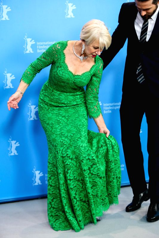 """Helen Mirren (L) and Ryan Reynolds arrive for a photocall for the promotion of the movie """"Woman in Gold"""" at the 65th Berlinale International Film Festival .."""