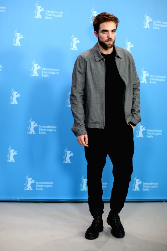 """Robert Pattinson poses for photos during a photocall for the promotion of the movie """"Life"""" at the 65th Berlinale International Film Festival in Berlin, ..."""