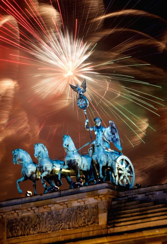 Fireworks light the sky over Brandenburg Gate during the celebration for the New Year in Berlin, Germany on Jan. 1, 2015.