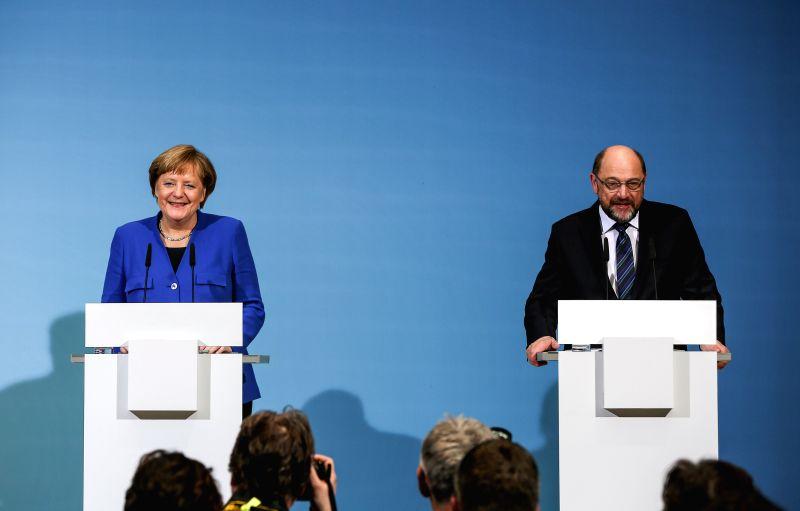 BERLIN, Jan. 12, 2018 - German Chancellor and leader of German Christian Democratic Union (CDU) Angela Merkel (L) and leader of German Social Democratic Party (SPD) Martin Schulz attend a joint press ...