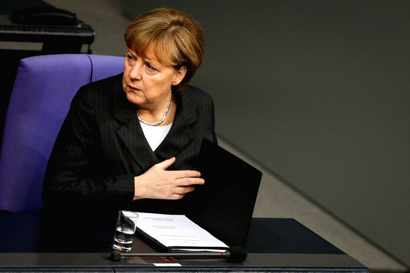 German Chancellor Angela Merkel attends a special session in commemoration of the victims of French Charlie Hebdo attack and ensuing armed standoffs at the ...