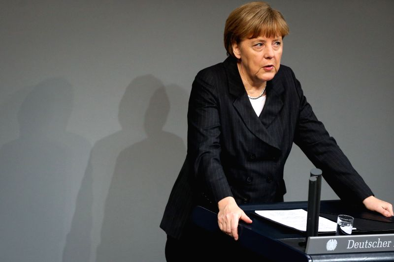 German Chancellor Angela Merkel speaks during a special session in commemoration of the victims of French Charlie Hebdo attack and ensuing armed standoffs at the ...