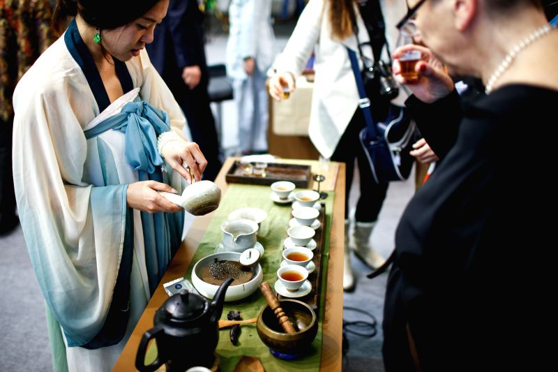 A staff member displays Chinese tea culture at China's stand during the 80th International Green Week in Berlin, Germany, on Jan. 16, 2015.  The 80th International ..