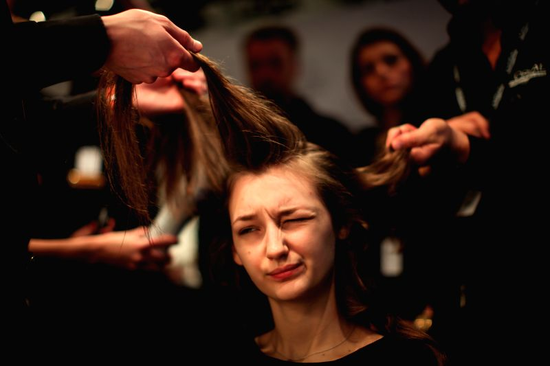 A model prepares for the display of Germany's Minx bu Eva Lutz during the Mercedes-Benz Fashion Week Berlin Autumn/Winter 2015 in Berlin, Germany on Jan. 20, 2015. ..